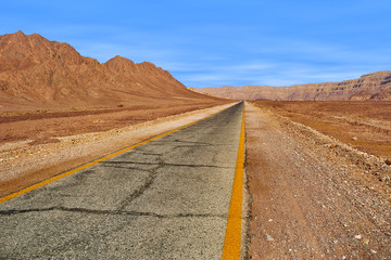 Road through red mountains in Timna park, Israel.