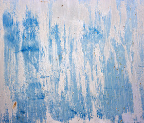 Blue abstract background. Old metallic plate with paint.