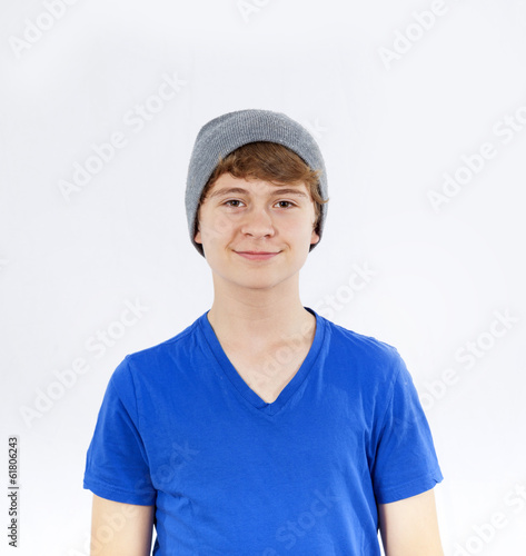portrait of cool smiling teenage boy with cap