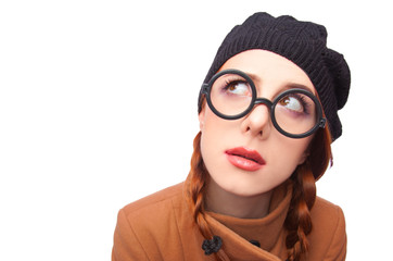 Surprised redhead women in glasses.