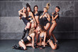 Seven Cute go-go sexy girls in black with diamonds costume playi