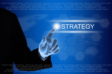 business hand clicking strategy button on touch screen