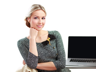 A young woman with a laptop sitting