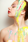 Beautiful woman painted with many vivid colors