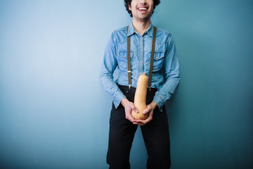 Happy young farmer holding a squash