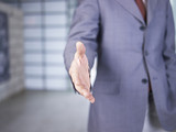 business person reaching out for handshake
