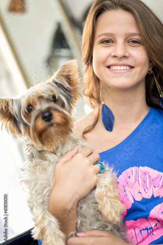 Smiling girl with her dog