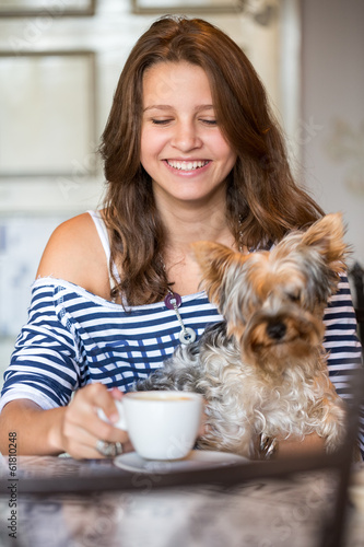 Happy smiling teen girl holding little dog