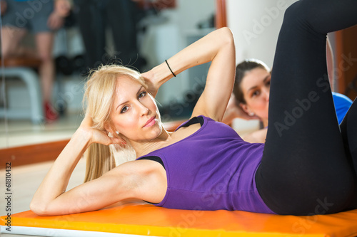 girls doing exercise for stomach muscles