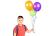 Schoolboy with bag holding a bunch of balloons