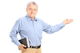 Male teacher holding a book and gesturing with his hand