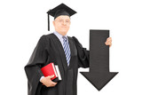 Mature man in graduation gown holding big black arrow