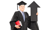 Mature man in graduation gown holding arrow pointing up