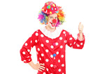 Smiling happy clown in red costume giving thumb up