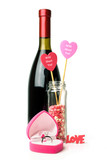 Ring in a box in the shape of heart with wine bottle