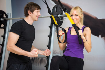 Personal trainer assist woman