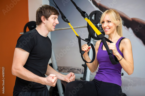 Sportswoman exercising with a resistance band