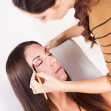 Makeup artist darkening eyes with eye shadow