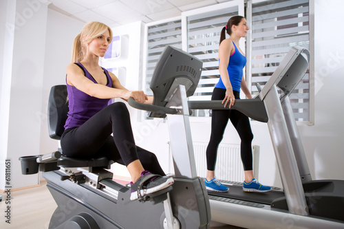 Sporty women exercising in gym.