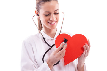 Woman wearing a white coat with a Heart