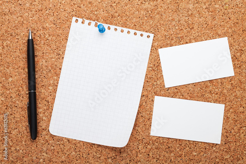 Blank notepad paper, business cards and pen