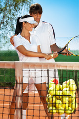 sportswoman with tennis instructor