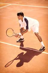 man plays tennis