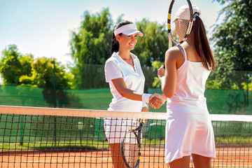 Tennis players giving handshake