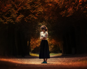 Art portrait of a lonely girl in the woods
