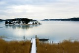 Seascape with snow at the east coast in Sweden.