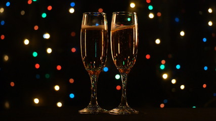 Two glasses of champagne found on holiday background