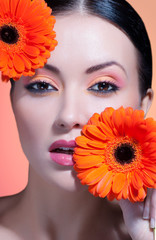 beautiful woman with stylish make-up and bright flowers