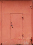Red metal garage wall with locked door. Background texture