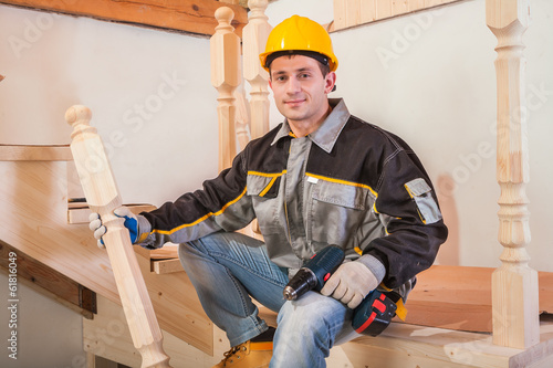 carpentery worker sitting on ladder
