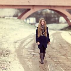 Beautiful girl walking along a winter