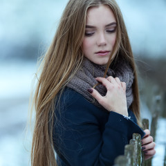 Sensual closeup portrait of beautiful girl in winter