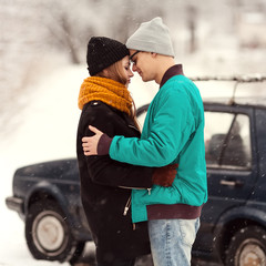 outdoor fashion portrait of young sensual couple in winter