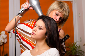 Girl making hair in hairdressing salon