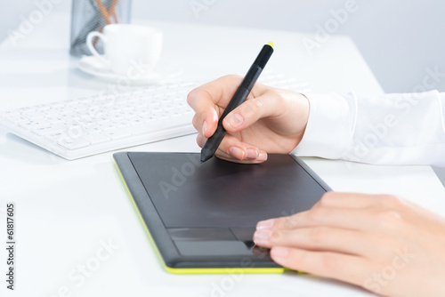 Designer hand drawing a graph on the tablet