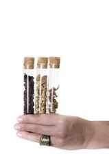 Three essences test tube on a hand