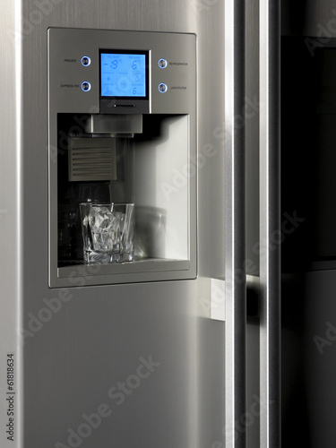 Refrigerator control display and ice dispenser with glass