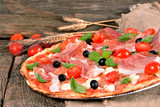 Italian pizza with ham and mozzarella cheese