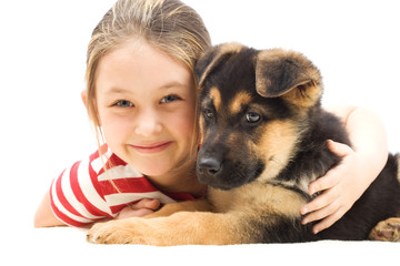 girl embraces a puppy