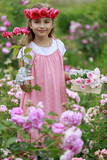 Rose garden - lovely  girl playing in the rose garden