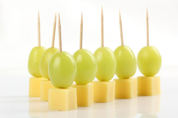Appetizer - Grape with cheese on white background