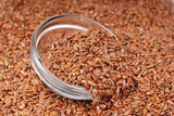 close up of flax seeds and bowl food background