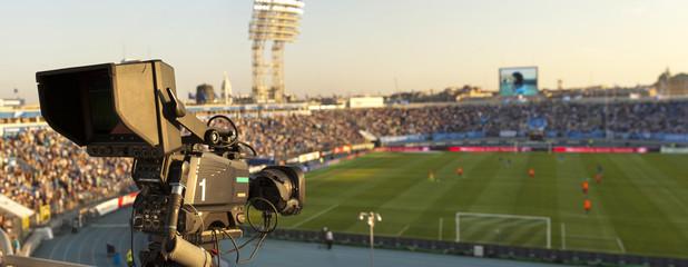 TV at the soccer. video camera back football goal