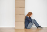 Woman Crying Next to Moving Boxes