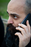 long bearded man on the phone