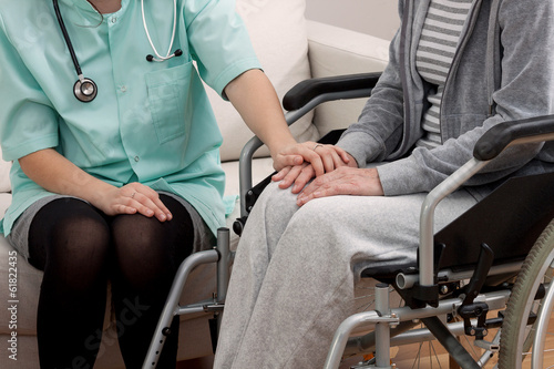 Doctor talking with aged patient